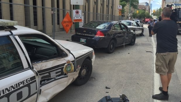 Two marked Winnipeg police cruisers were among five vehicles damaged on July 20. The other three were unmarked police cars.