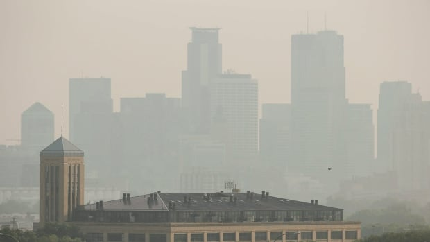 The Minneapolis skyline is shown on July 6. Wildfires in Saskatchewan this summer have led to smog warnings in Minnesota, Iowa and both Dakotas, showing how far air pollution particles can travel.