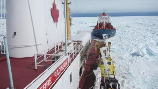 The CCGS Pierre Radisson escorts the oil tanker Havelstern to Iqaluit July 17. Tough ice conditions in area have delayed this summer's annual resupply, and have now derailed the CCGS Amundsen from its carefully planned summer research program.