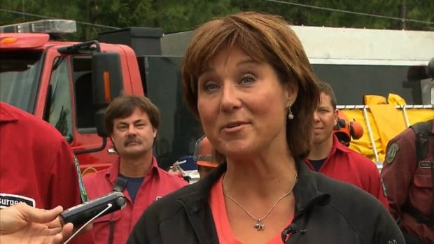 Christy Clark spoke from the scene of a wildfire burning near West Kelowna, B.C.