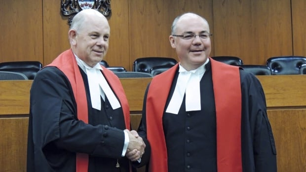 Justice Russell Brown, right, is congratulated by Associate Chief Justice John Rooke after being sworn in to the Alberta Court of Queen's Bench in 2013. Brown has been named to the Supreme Court of Canada by Prime Minister Stephen Harper.