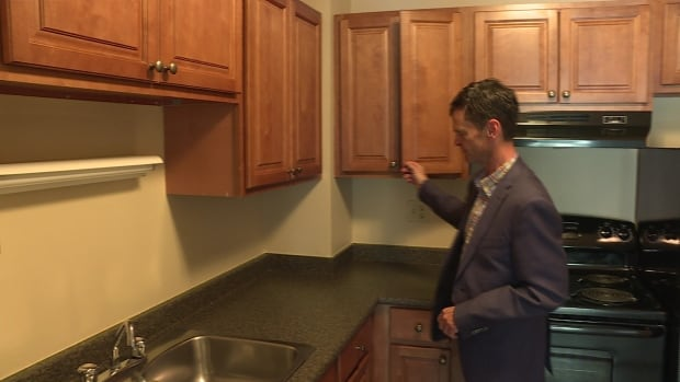 David McIlveen from Boardwalk Properties shows off a kitchen in a vacant apartment in Calgary.