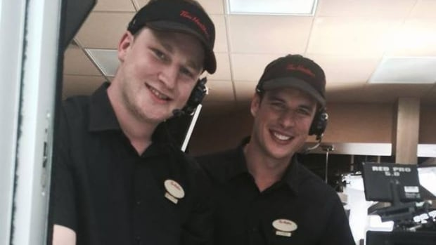 Nathan MacKinnon (left) and Sidney Crosby served up some coffee at a Tim Hortons in Nova Scotia on Monday.