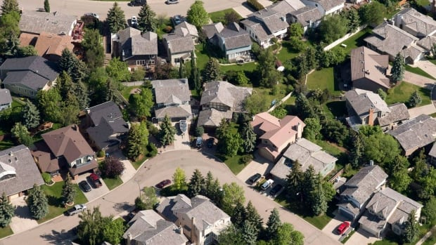 Aerial view of housing in Calgary where double-digit increases in property prices have changed to declines as the oil industry shrinks. Canadian real estate markets may go off the boil even further as interest rates start to rise, says Don Pittis. If so, expect to see more irregularities in the industry.