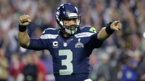 Russell Wilson, quarterback, agrees to contract with Seahawks