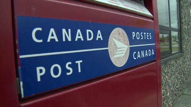 Canada Post letter drop box close up