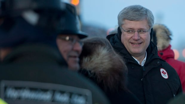 Prime Minister Stephen Harper greets workers at the construction site of the Inuvik to Tuktoyaktuk highway in Inuvik, N.W.T. in January 2014. Nestled in the spate of last-minute government announcements ahead of the expected writ drop are a handful of funding pledges for the Arctic.