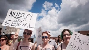 Kitchener sisters hold rally for women's topless rights
