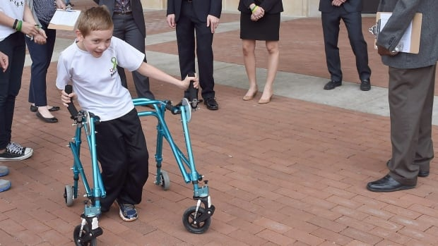Braden Gandee, 8, who has cerebral palsy, tries out a new customized walker in Ann Arbor, Mich. An estimated 50,000 Canadian children and adults have the condition, which leads to varying degrees of motor impairment, including muscle spasticity and involuntary movements.