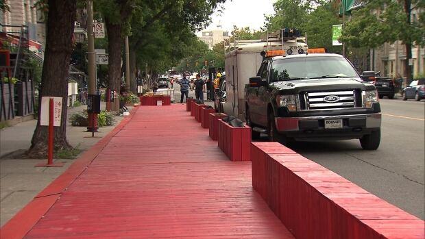 Big, red terrasse installation on St Denis St underway