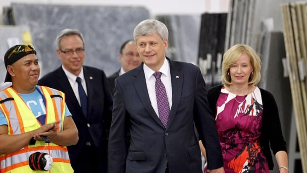 Home renovator? Stephen Harper and his wife Laureen visit a tile and stone manufacturing company in Toronto on Tuesday, when he promised to bring back a popular home renovation tax credit that he previously axed.