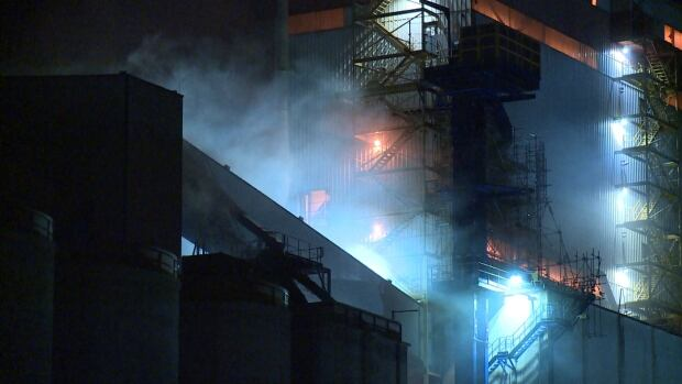 A fire deep inside a North Vancouver grain facility sent smoke billowing into the air on Wednesday night.