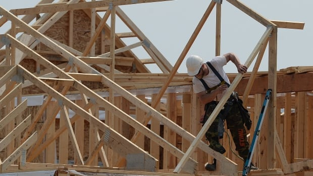 Construction workers build new homes in a development in Ottawa. A survey of human resource managers across Canada found they expect wages to rise 2.5 per cent in 2016.