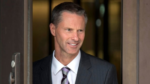 Nigel Wright, former chief of staff to Prime Minister Stephen Harper, arrives at the courthouse in Ottawa to testify Wednesday in the trial of Senator Mike Duffy.