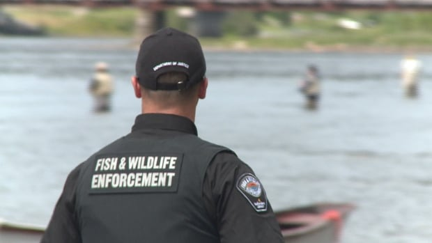 The officers were in street clothes when they apprehended the two alleged salmon poachers.