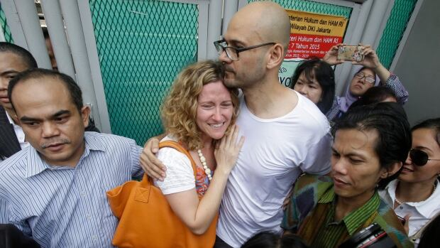 Canadian teacher Neil Bantleman, right, hugs his wife Tracy, left, after he was released from Cipinang prison in Jakarta, Indonesia, in August.