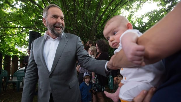 NDP Leader Tom Mulcair makes a campaign stop in the backyard of a home in Vancouver. B.C. voters could potentially hold the balance of power in this election.