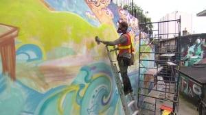 Kyle Bustin working on mural in Scanlan's Lane in St. John's