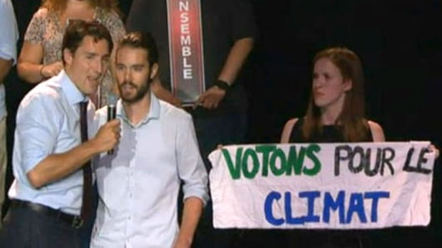 Justin Trudeau, left, answers a question on emissions targets from protester Sam Quigley, centre, and Julianna Deholke, right, at a campaign event in August. Now, observers say, Trudeau and his advisers have the task of convincing the world Canada is serious about tackling climate change.