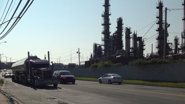 A fuel truck leaves the Dartmouth refinery late Monday morning.