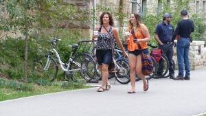 Women walk through University of Saskatchewan campus