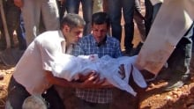 Drowned Syrian boys, mother buried in Kobani