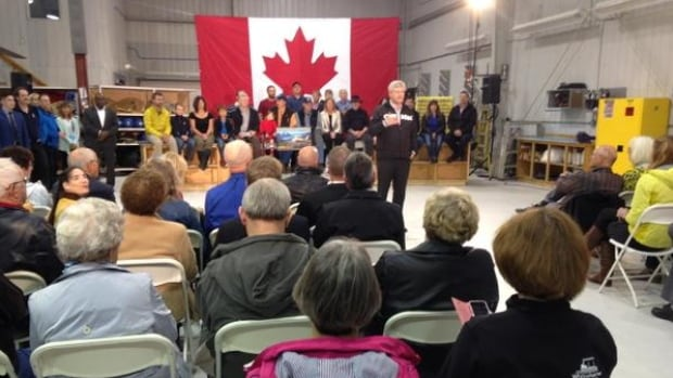 Conservative Leader Stephen Harper speaks at Trans North Helicopters hangar in Whitehorse during a campaign visit to Yukon on Friday.