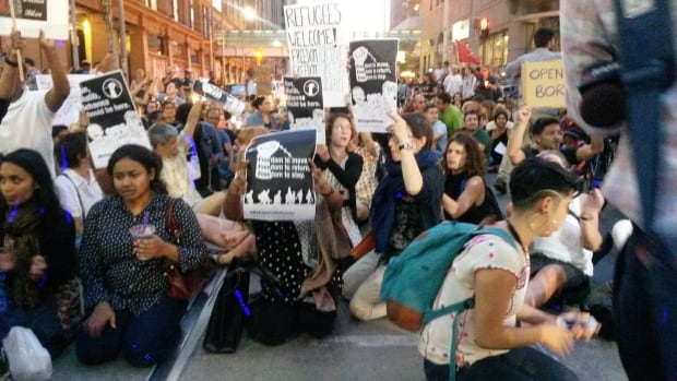 A march in downtown Toronto began at Yonge-Dundas Square and included a sit-in, blocking traffic for about an hour.