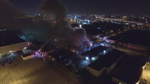 More than 80 firefighters battled a huge garage fire in Etobicoke Saturday night. No one was injured in the 4-alarm fire that Toronto Fire estimates caused nearly $1 million in damages. (Pascal Marchand)