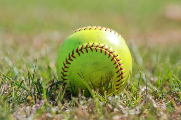 softball in field baseball yellow grass
