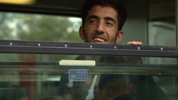 Hawkar Ali Fattah, a Kurdish refugee who fled northern Iraq, looks out the window of a train headed from Nickelsdorf, Austria, to Munich. Fattah says he and other asylum seekers have been mistreated along their arduous route through southern and eastern Europe.