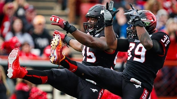 Freddie Bishop III, left, Charleston Hughes and the Stamps got a leg up on Edmonton on Labour Day.