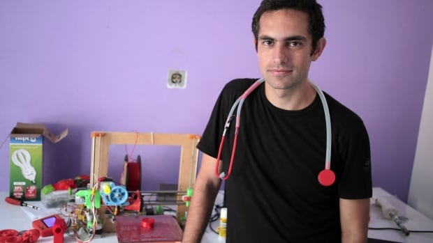 Dr. Tarek Loubani poses with 3D printed stethoscope around his neck in Gaza City in this Sept. 7, 2015 photo. In a territory lacking many basic medical supplies, Loubani says he has designed a stethoscope that can be made for a fraction of the cost of leading brands.