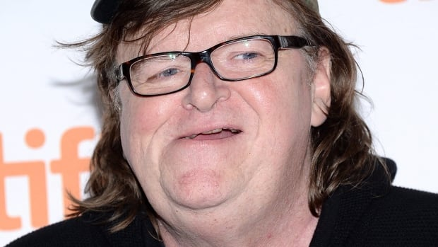 """Director Michael Moore claims """"truck after truck after truck, every hour of every day"""" cross the Blue Water Bridge in Sarnia """"to dump the garbage of Toronto in landfills in and around Flint."""""""