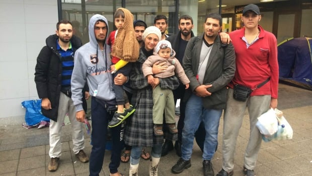Syrian refugee Ahmed Yusef al Khalid (third from right) with his family and friends at a train station in Budapest, Hungary, Sept. 11, 2015.
