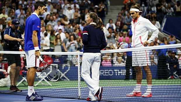 Chair umpire Eva Asderaki-Moore, middle, didn't miss a call in the U.S. Open final between Roger Federer, right, and Novak Djokovic, left, on Sunday night.
