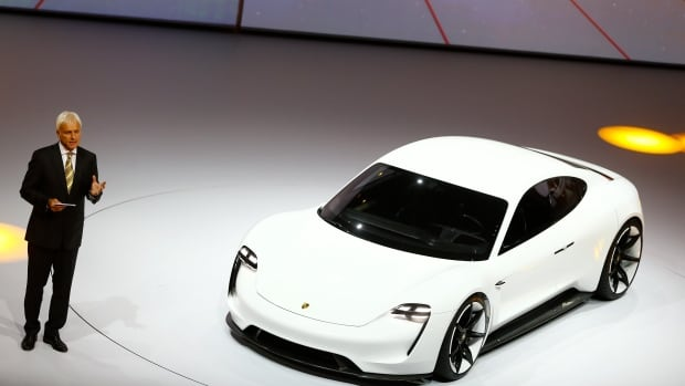 Porsche CEO Matthias Mueller presents the new electric Porsche Mission E concept car in Frankfurt on Monday evening.
