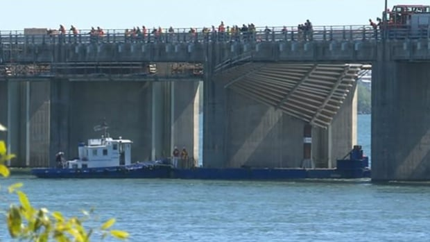A construction worker is missing after the scaffolding he was working on unhooked from the edge of the Champlain ice bridge on Tuesday.