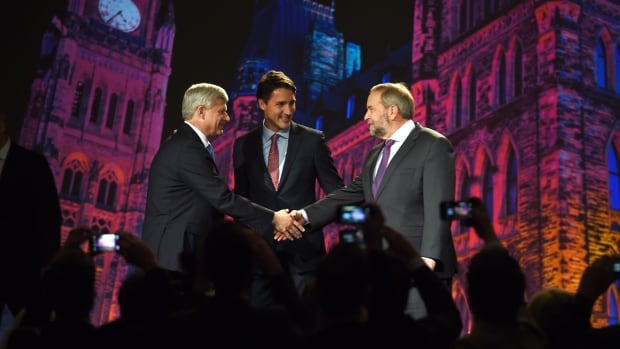 Stephen Harper, Justin Trudeau, and Tom Mulcair shake hands before the Globe and Mail leaders' debate in Calgary. The debate's set — an eerily lit Parliament vista — drew plenty of remarks online.
