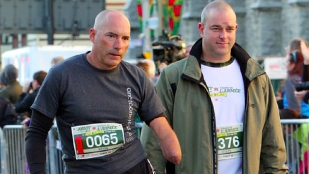 Bryan Cuerrier did the Army Run in September 2012, and is seen here with Mathieu Giard, a soldier who had volunteered to walk alongside of him for the event.