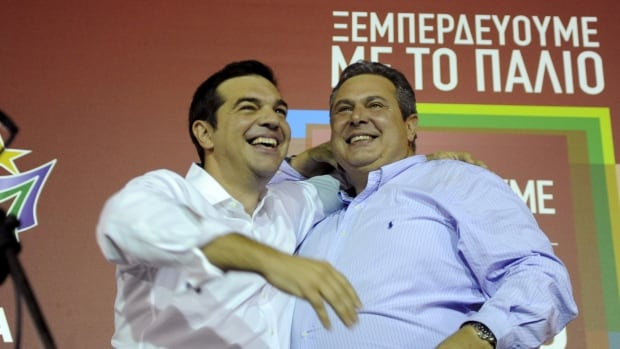 The Leader of the leftist Syriza party Alexis Tsipras, left, hugs coalition partner and leader of the Independent Greeks party Panos Kammenos in Athens on Sunday.