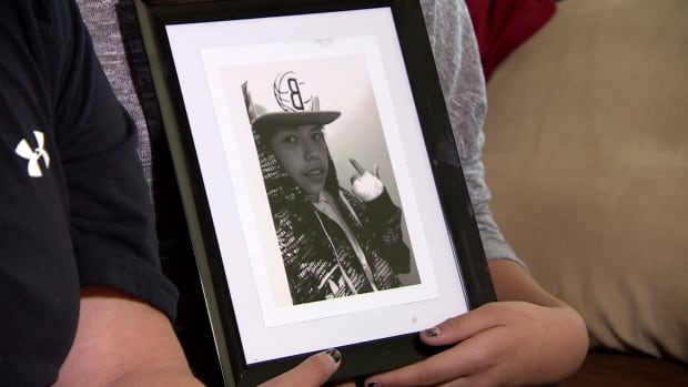 Family members hold a picture of Haven Dubois, 14, who was found in cardiac arrest in a Regina creek on May 20, 2015.