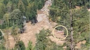 A two storey house in the Birken north of Pemberton is buried up to its roof line in mud. It's the structure in the circle. (Mike McArthur/CBC)