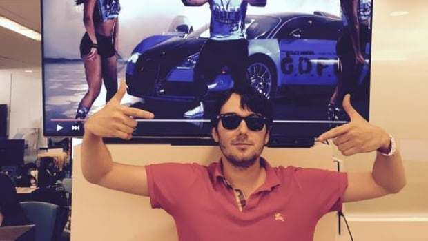Martin Shkreli, CEO of New York City-based Turing Pharmaceuticals, pictured in  a photo posted on his Twitter feed, said hiking the price of anti-parasitic medication Daraprim by 5,000 per cent allows the company to make 'a reasonable profit.'  After an enormous public outcry, he told ABC News on Tuesday his company would lower the price.
