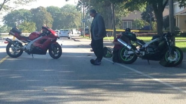 Ontario SIU investigators probe a motorcycle crash on Riverside Drive. An OPP officer has decided to quit driving his motorcycle after visiting with three crash victims in the past week. (Alex Brockman/CBC)