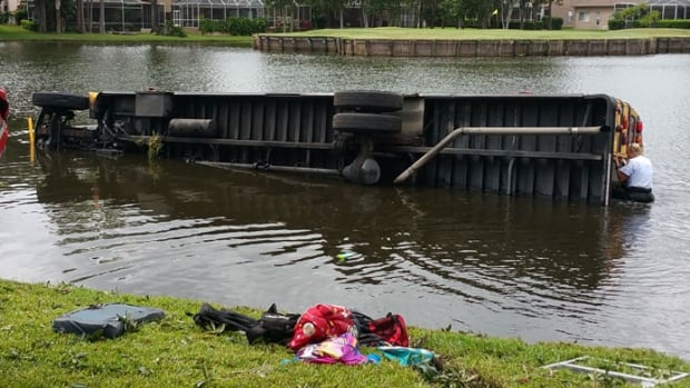 Tom Batchilder, who used to live on P.E.I., jumped into an alligator-infested lake to help rescue children from a semi-submerged school bus.