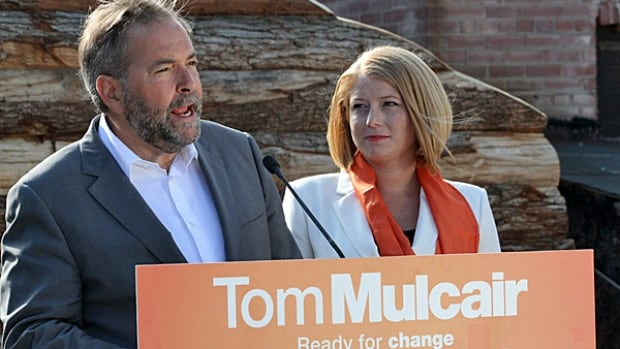 Alex Johnstone, the NDP candidate for Hamilton West-Ancaster-Dundas, seen here with NDP Leader Thomas Mulcair, has been criticized on social media for telling the Hamilton Spectator that she 'didn't know what Auschwitz was.'