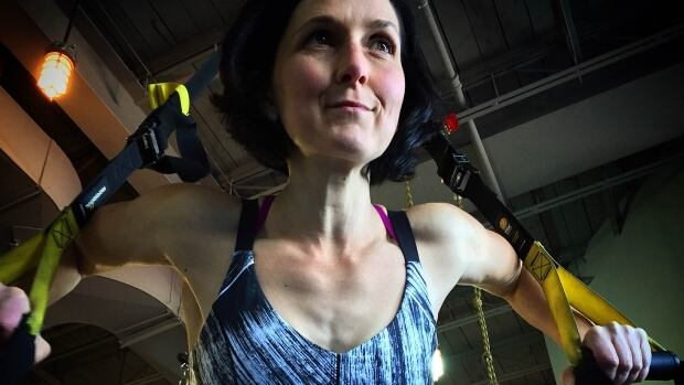 A  pulley and strap system, like this TRX system, can be a good alternative to a traditional weight workout, says Jeff Woods.