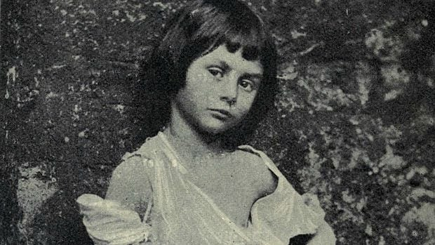 """Alice Liddell at age 6, posing as """"The Beggar Maid."""" This photo, taken by Lewis Carroll, has given rise to speculation about the relationship between the Oxford don and the precocious little girl who inspired him to write """"Alice's Adventures in Wonderland."""""""