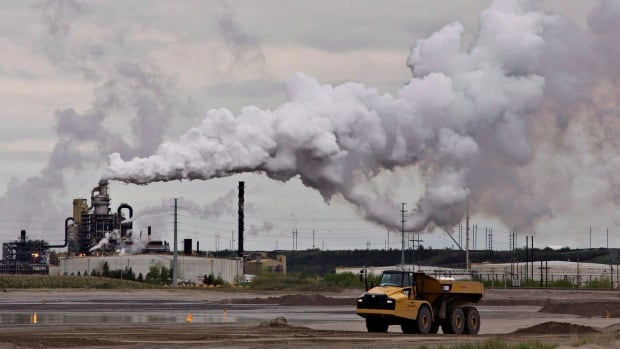 A dump truck works near the Syncrude oil sands extraction facility near the town of Fort McMurray, Alberta in June 2014. Revenue raised by putting a price on carbon will be plowed back into the provinces to help them cut greenhouse gases.